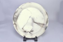 ANTONIA SALMON (born 1959); a large smoke fired stoneware platter, burnished with incised rim,