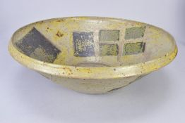 CHARLES BOUND (born 1939); an early large stoneware bowl decorated with a pattern of squares,
