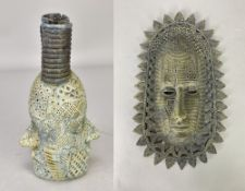 ALASDAIR NEIL MACDONELL (born 1947); a stoneware bottle form with two faces and a face mask wall