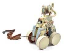 ALAN HEAPS, later known as Alan Sidney, (born 1941); a fantasy stoneware sculpture of a four wheel