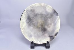 ANTONIA SALMON (born 1959); a smoke fired stoneware dish, burnished with incised decoration, incised