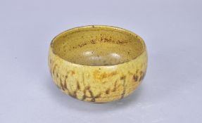 ANDREW MARSHALL (born 1952); a stoneware bowl covered in ash and iron glaze, impressed AM mark,