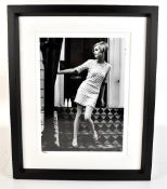 An iconic black and white limited edition photographic print of Twiggy with blind stamp for the