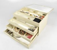 A group of costume jewellery with earrings including floral motif examples set with variously
