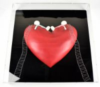 DOUG HYDE (born 1972); a three dimensional wall sculpture, 'High on Love (Objet D'Art)',encased in