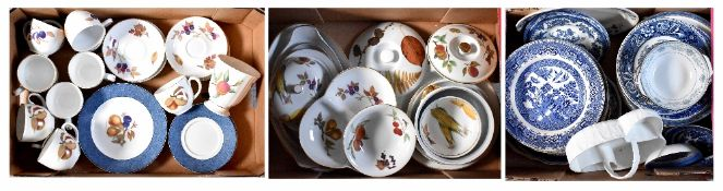 A Royal Worcester 'Evesham' ware part dinner and tea service comprising covered tureens,