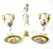 A pair of German porcelain vases with twin gilt handles and floral decoration, marked Alka Kunst,
