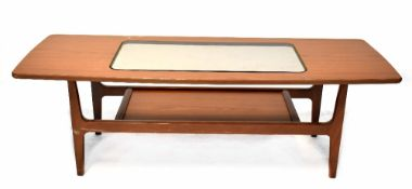 A Schreiber teak coffee table of rectangular form with inset smoky glass centre above undershelf,
