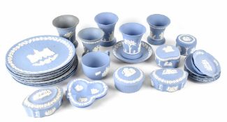 A mixed collection of Wedgwood blue jasper ware to include five small campana shaped vases,