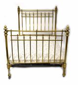 An Edwardian-style decorative brass double bed frame, brass finials to top and base, width 138cm,