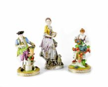 Two 19th century Dresden porcelain figures, one depicting a girl picking flowers,