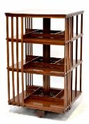 An Edwardian mahogany revolving bookcase with square top and three tiers,
