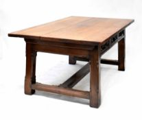A large oak Gothic Revival refectory table with three drawers to each side with carved decoration