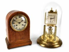 An early 19th century Waring & Gillows Ltd London & Paris inlaid mahogany dome-top table clock with