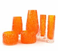 Six pieces of Whitefriars tangerine-coloured art glass to include a Coffin vase, height 13cm,