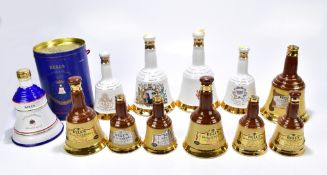 WHISKY; five Bell's blended Whiskies in commemorative ceramic decanters, one with outer box for