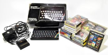A boxed Sinclair ZX Spectrum Personal Computer and selection of games (box af).Additional