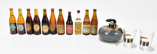 A group of miniatures with four Guinness, four Harp larger, single Manns and Smithwick's ale