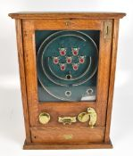 An early 20th century oak cased allwin machine,complete with two keys,height 65cm,width 45cm.