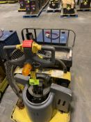 Pallet jack with battery charger