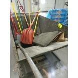 Dumpster with shovels and brooms