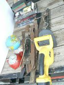 STACK OF BOOKS, LAWNMOWER BLADES, GLOBE BANK, HEDGE TRIMMER