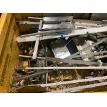 large skid of stainless steel conveyor parts