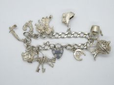 Vintage silver charm bracelet with 10x nice charms London 1978 35.9g
