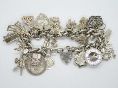 Heavy silver charm bracelet with 29 nice charms London 1978 114g