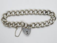 "Heavy vintage silver curb link bracelet with padlock and safety chain London 1968. 8.5"" 48g"