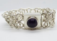 "Heavy modernist silver bracelet set with large cabochon amethyst 7.5"". 65g"