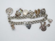 Vintage silver charm bracelet with 9x charms HM London 1978 52g