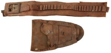 A 19TH CENTURY WESTERN GUN RIG OR HOLSTER ENSEMBLE, the leather belt accommodating forty cartridges,