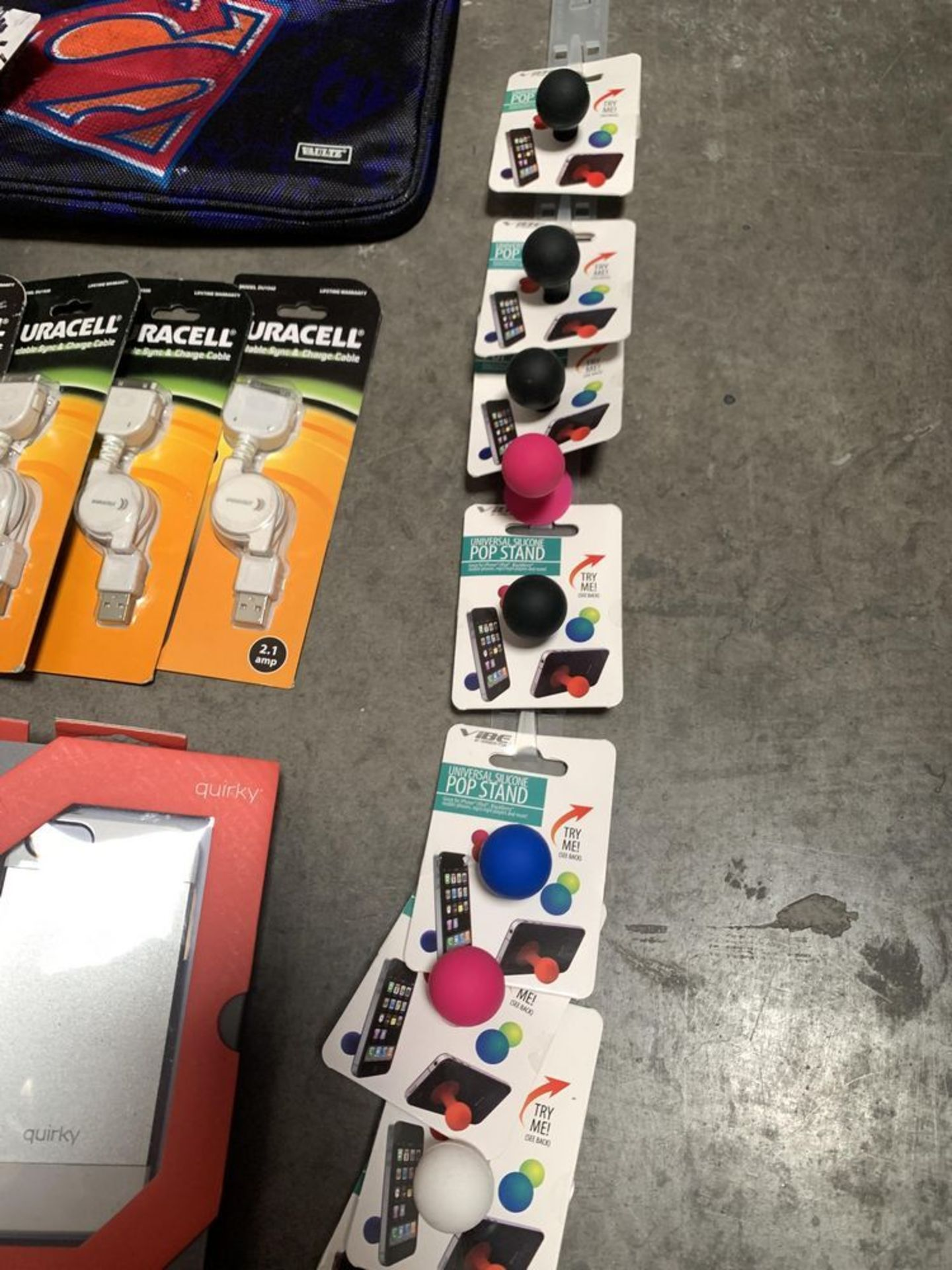 Lot 192 - Lot of 34 Phone Cases and Accessories, Including iPhone cases, iPhone stands, and Chargers