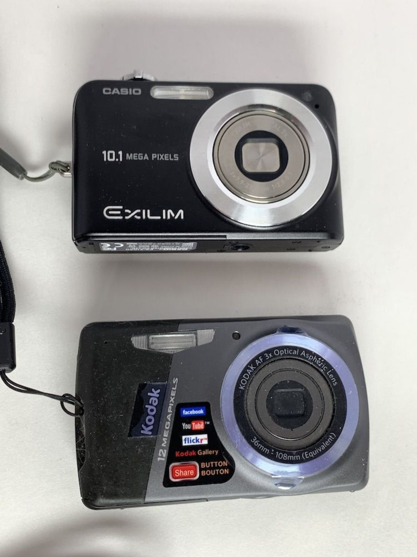 Lot 123 - 2 Digital Cameras and Cables with Written Material