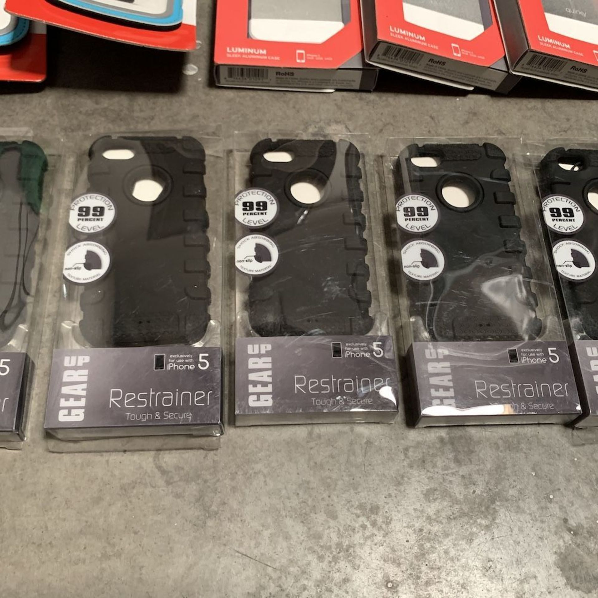 Lot 199 - Lot of 24 iPhone Cases, Chargers, and Phone Armband Accessories