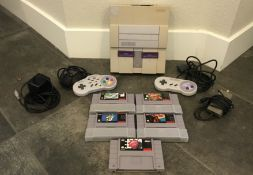 SUPER NINTENDO ENTERTAINMENT SYSTEM WITH TWO CONTROLLERS AND ADAPTERS, FIVE GAMES ALSO INCLUDED