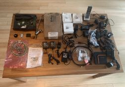 TABLE FULL OF SMALL ELECTRONIC ITEMS + MISC ITEMS