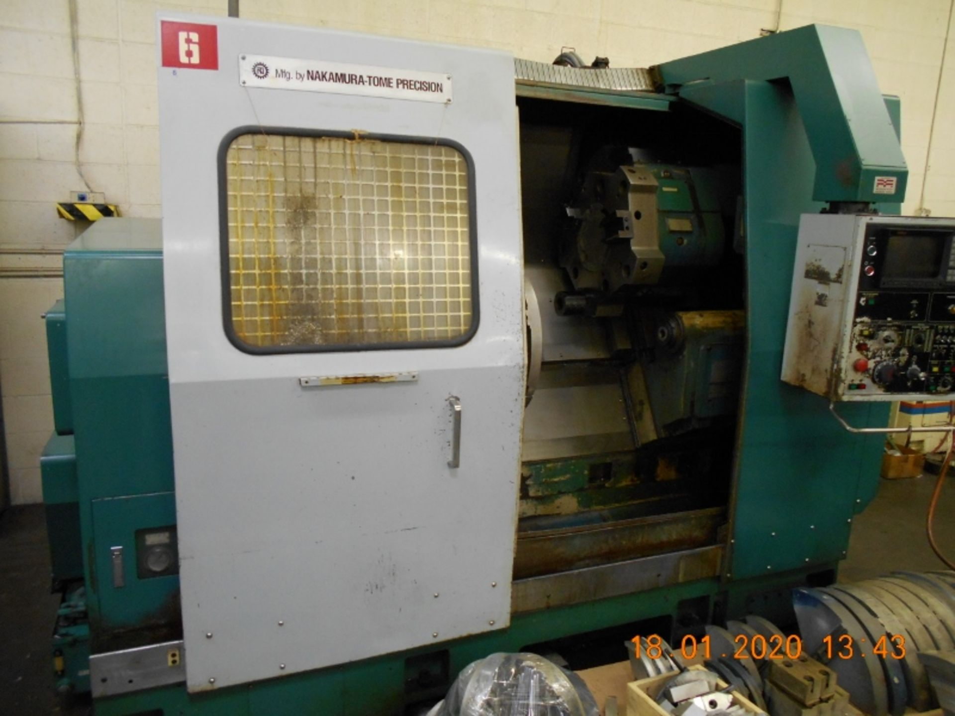 Lot 10 - Nakamura Tome Slant 4 CNC Turning Center with Fanuc 11T Controls SB-4 Serial # C44103 With 4 pallets