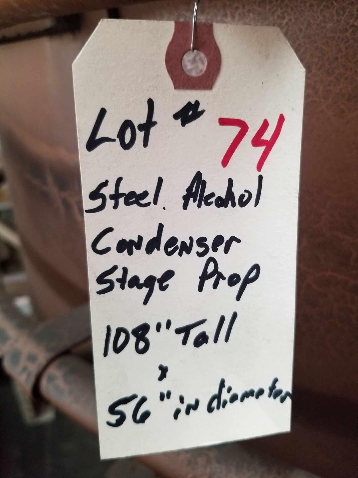 "Lot 74 - Steel Alcohol Condenser Stage Prop, 108"" tall x 56"" in diameter."