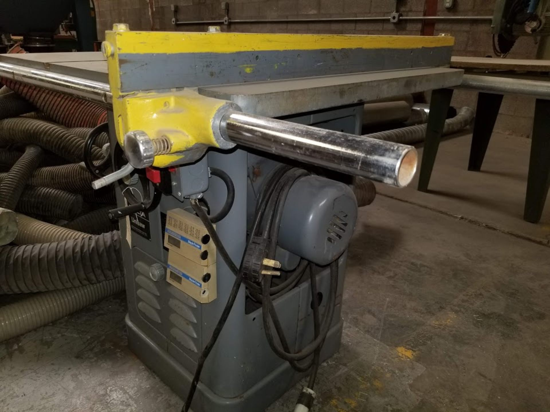 """Lot 24 - Delta 10"""" Unisaw 1.5HP 115/230 Volts Single Phase Motor, 25"""" Rail & Fence"""