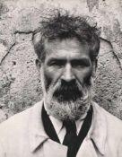 Constantin Brancusi in his work robe