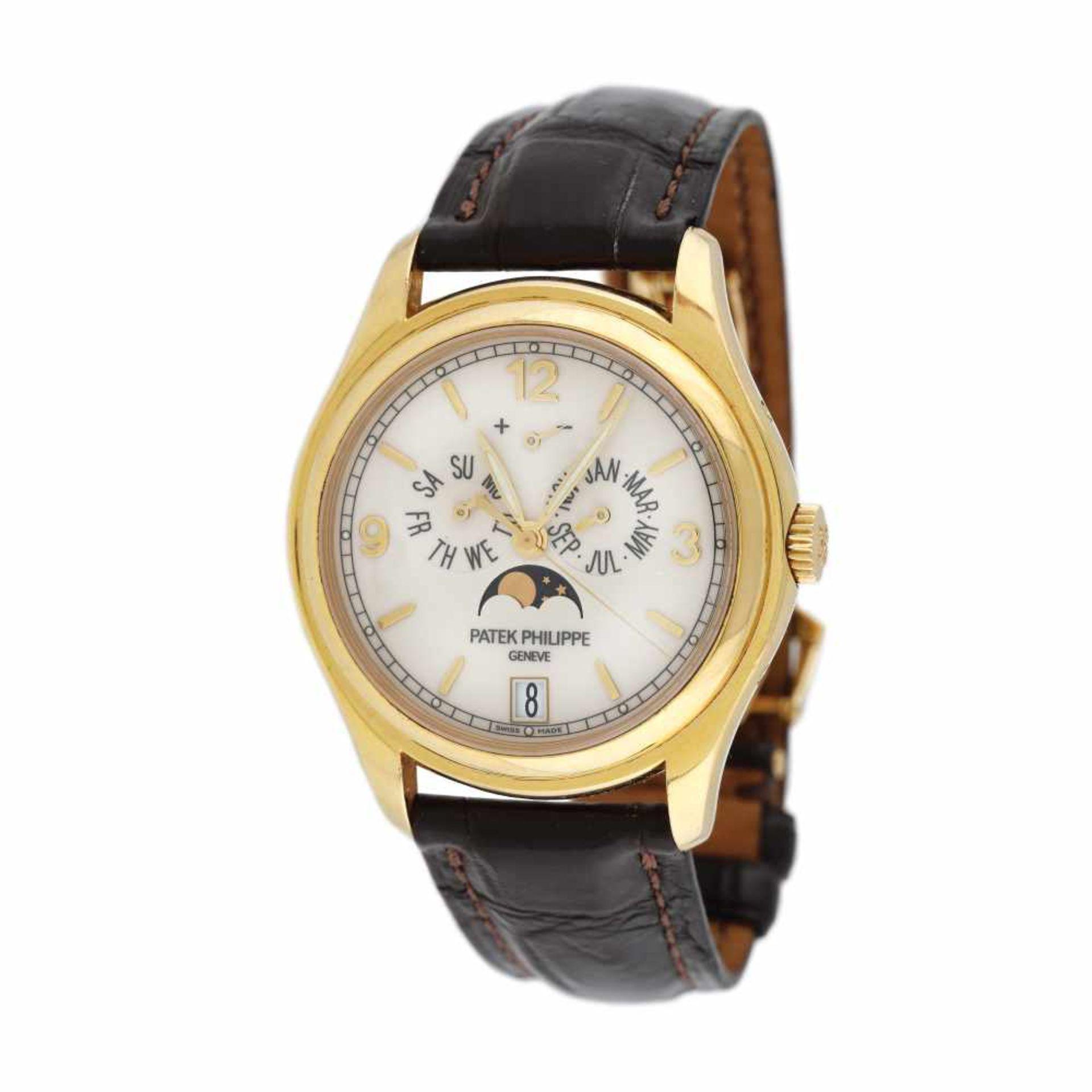Patek Philippe Annual Calendar Moon Phase wristwatch, gold, men, provenance documents and original b