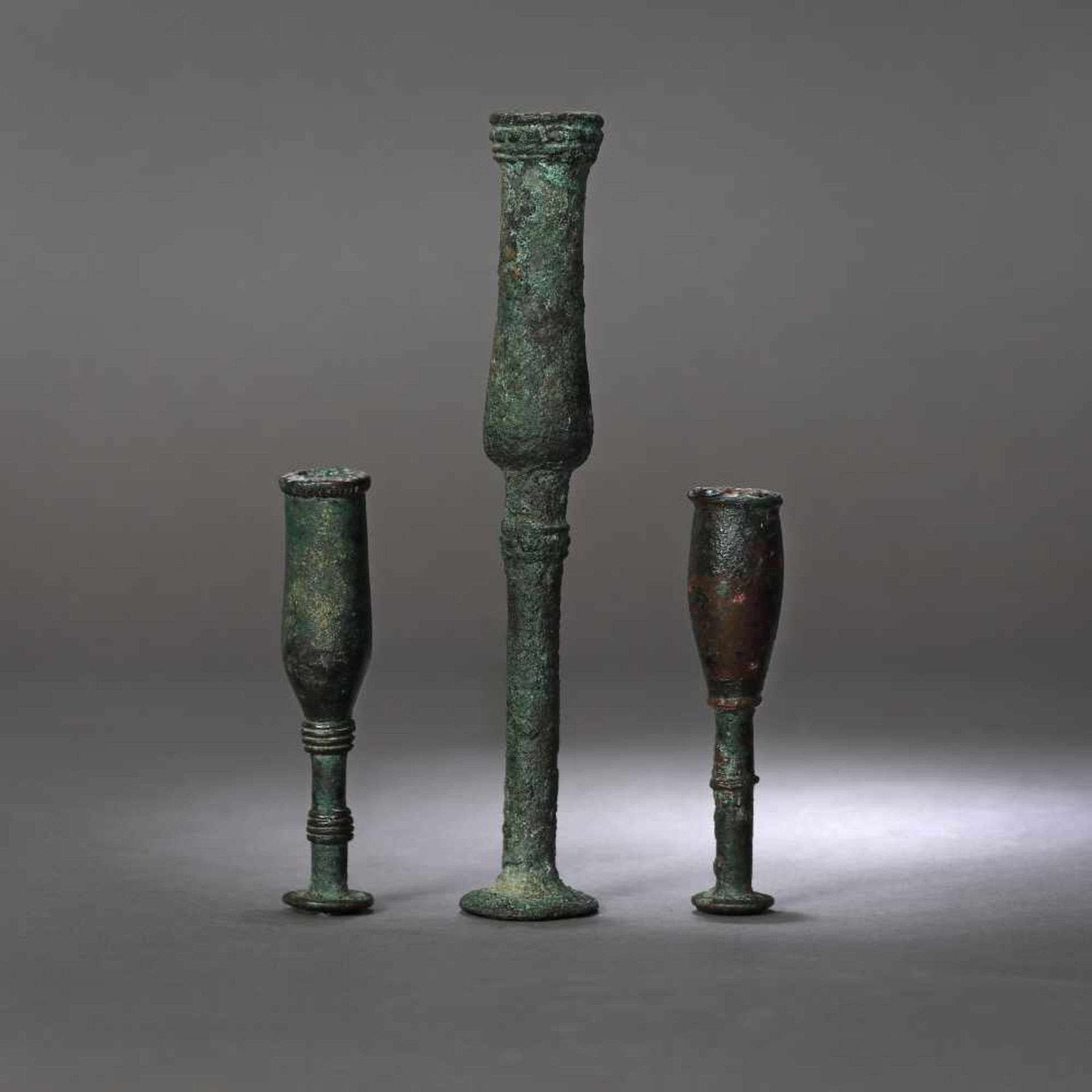 Three bronze candlesticks, possibly Luristan, Persia, the first part of the first millennium B.C.
