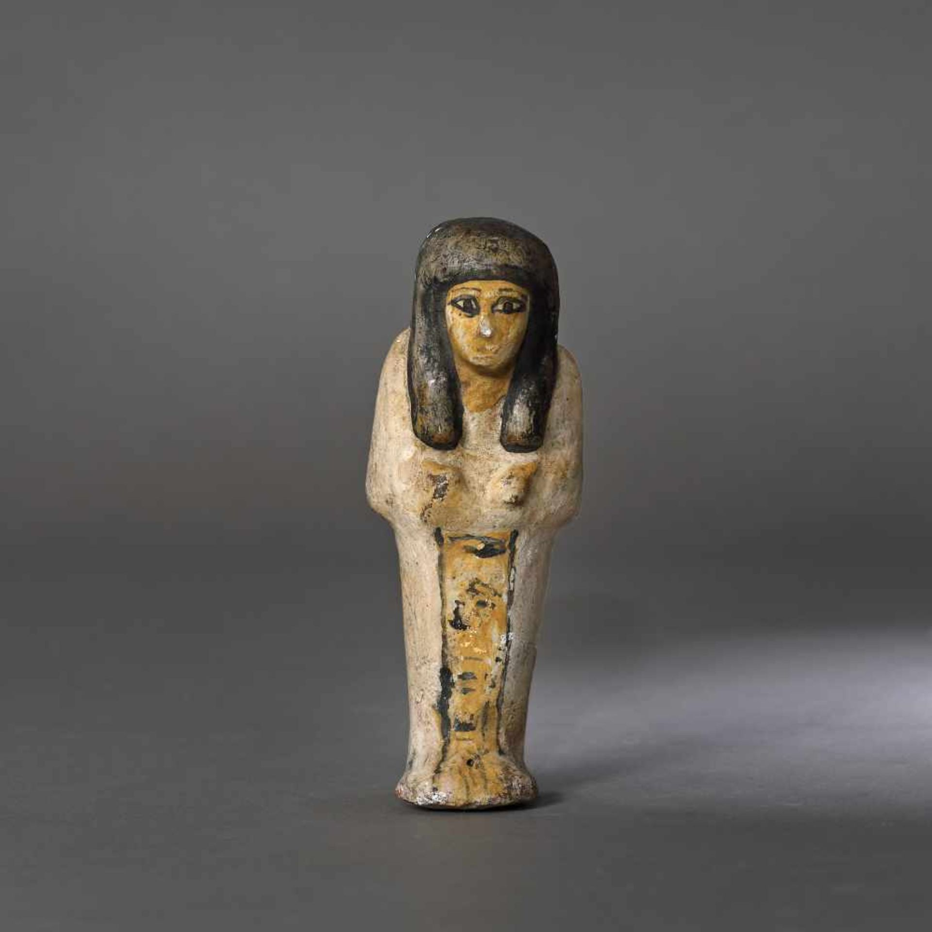 Egyptian painted ceramic statuette, representing a maid for the afterlife, probably the Late Dynasti