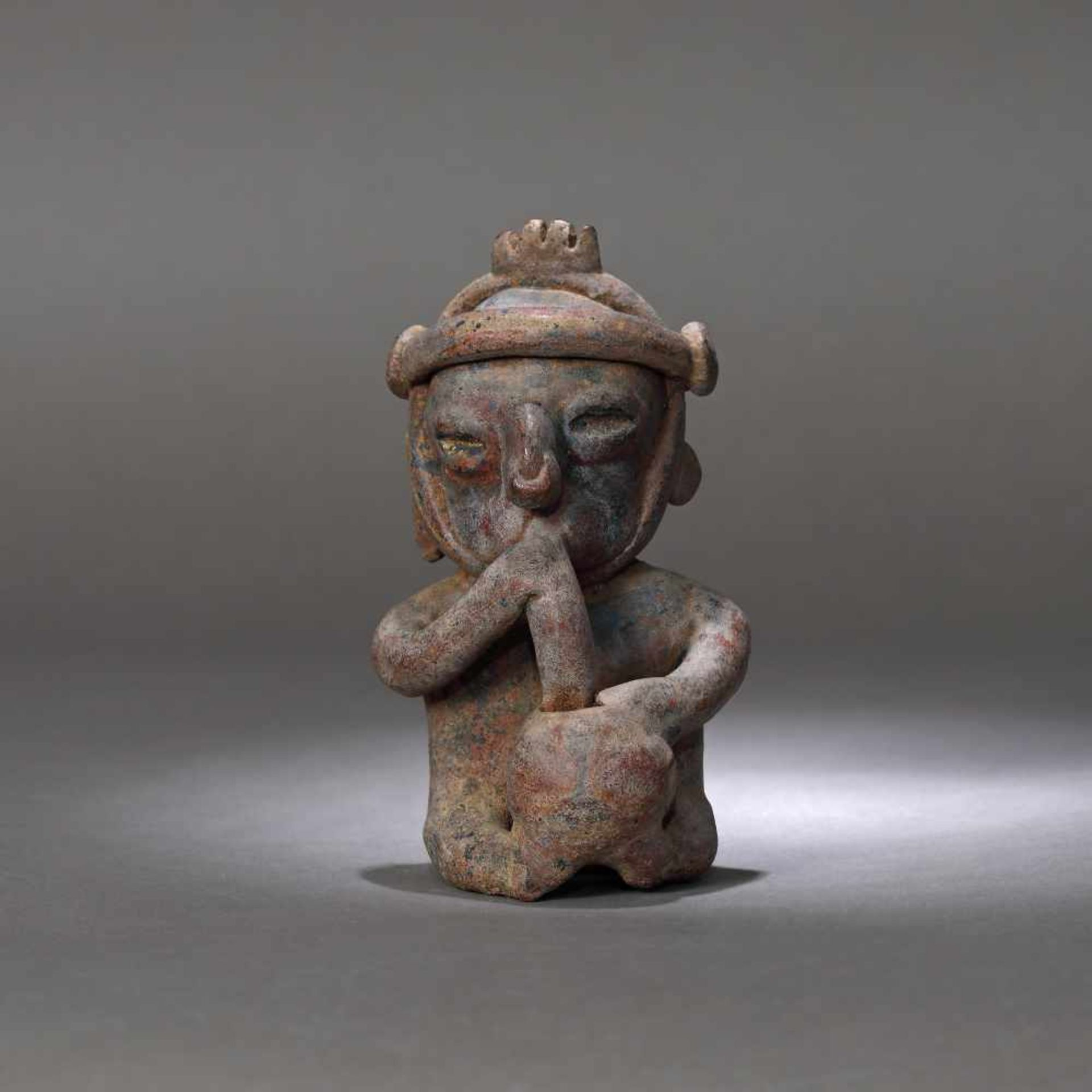 Ceramic figurine depicting a man smoking, Colima culture, Mexico, approx. 2,000 years old, 1st centu