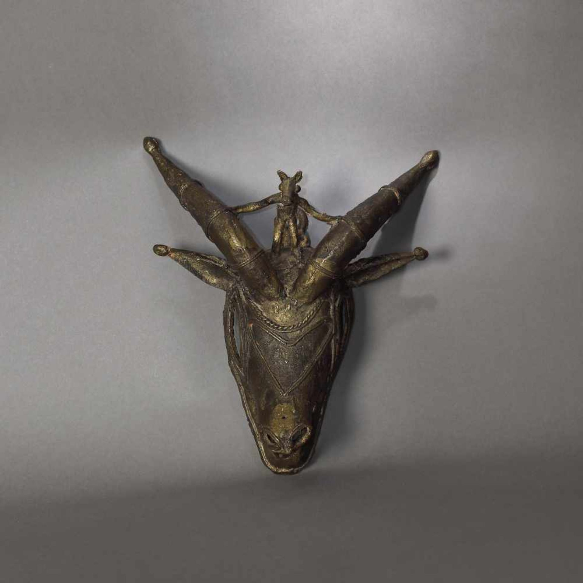 Bronze mask, representing a protective spirit (kponyungo), Ivory Coast, 19th century