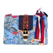 """Sylvie Flora"" - Gucci bag, leather, blue, decorated with vegetal motifs and metallic appliqué"