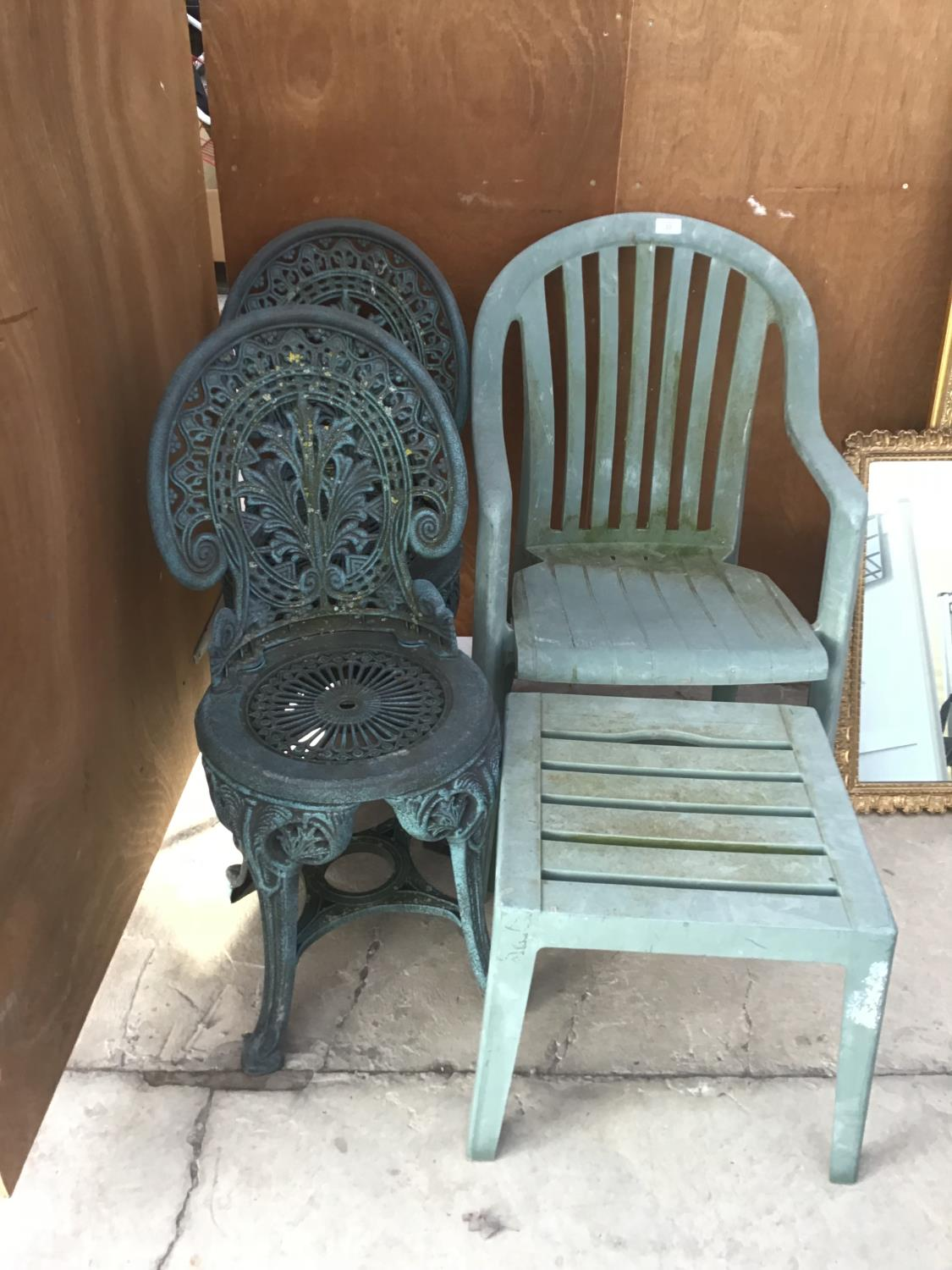 Lot 33 - THREE PLASTIC GARDEN CHAIRS AND A TABLE.