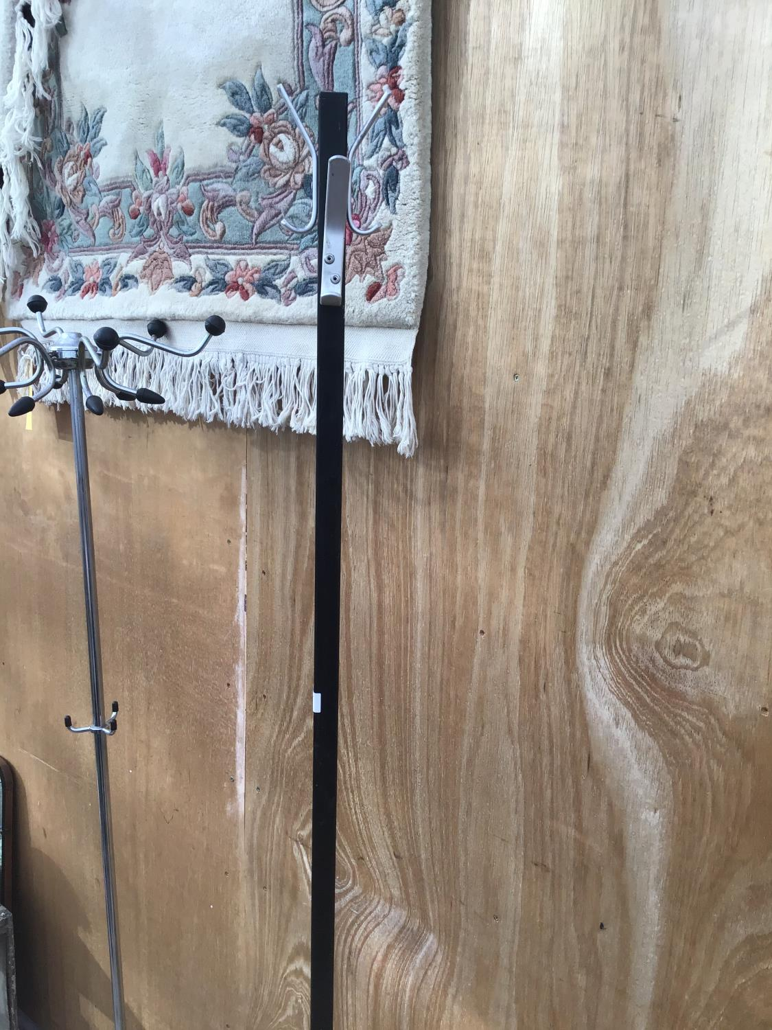 Lot 8 - TWO BLACK MODERN COAT STANDS AND A ROTATING CARD STAND